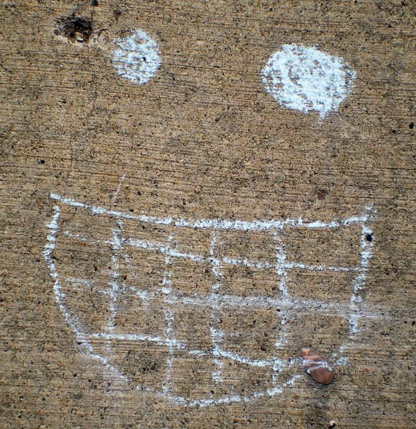photo of smiley face on sidewalk