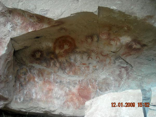 photo of cave of painted hands