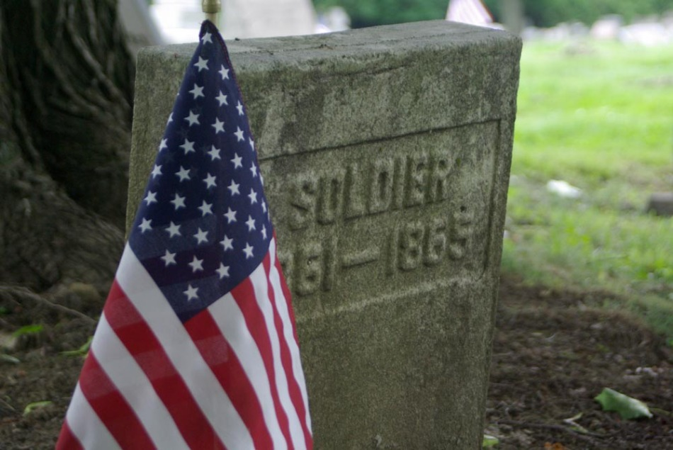 photo of headstone and flag