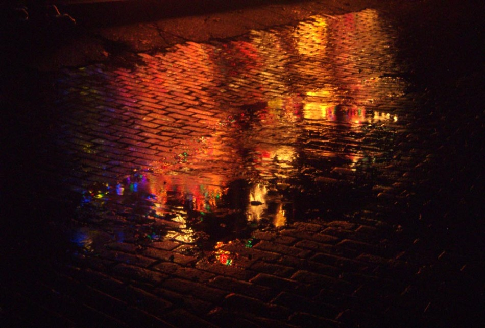 christmas lights reflected in puddle