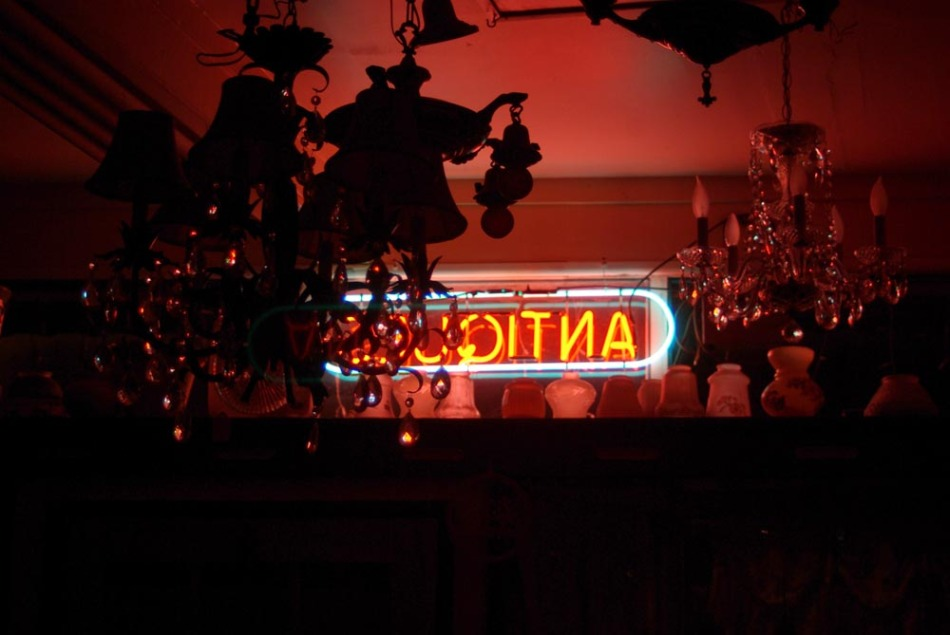 neon sign in an antique shop at night