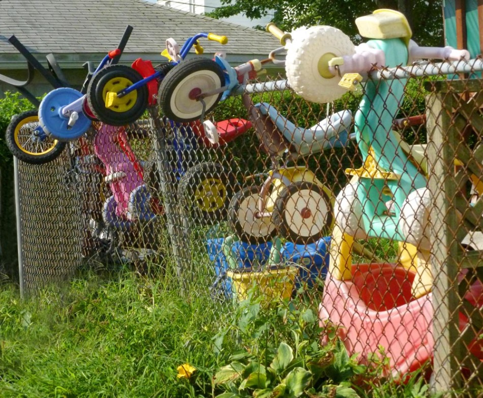 kids toys hanging on fence