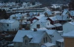 snow-covered houses at dusk