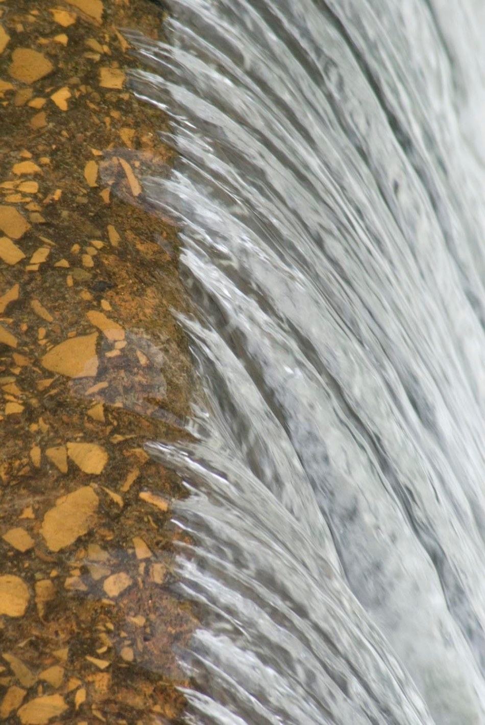 water flowing over dam