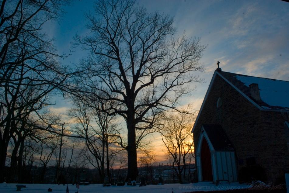 old church in winter sunset